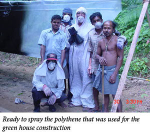 Uromi Goodale, Ready to spray the polythene that was used for the green house construction